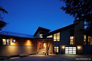 Drama On The Mount: A winding drive through nearly twelve mountain acres delivers ultimate privacy. Dramatic angled roof lines deliver architectural performance!